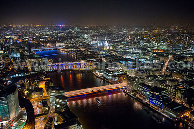 Aerial view looking West along the River Thames at night, London