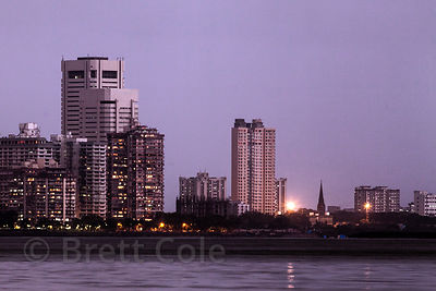Mumbai, India skyline at dusk including Back Bay (Arabian Sea), from Chowpatty Beach.
