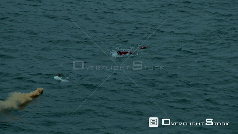 Aerial of a paramedic swimming towards a man in the sea Cape Town Western Cape South Africa