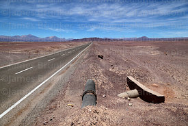Underground water pipe next to road across Atacama Desert near Calama, Region II, Chile