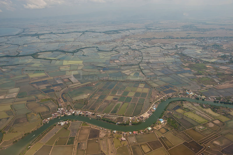 Aerial view of rice paddies and fish ponds in Makassar with river tributaries, South Sulawesi, Indonesia, Nvember 2009