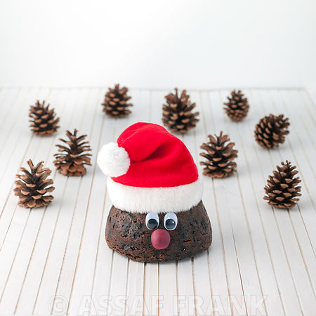 Christmas puddings with santa hat and pine cones