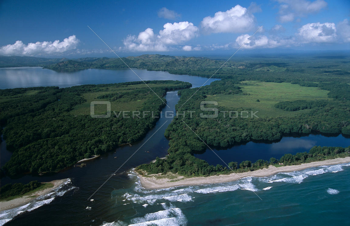 Aerial view of Miami (Caribbean) coast of Honduras with Laguna de los Micos (Lost Lagoon) in the background, Honduras, centra...