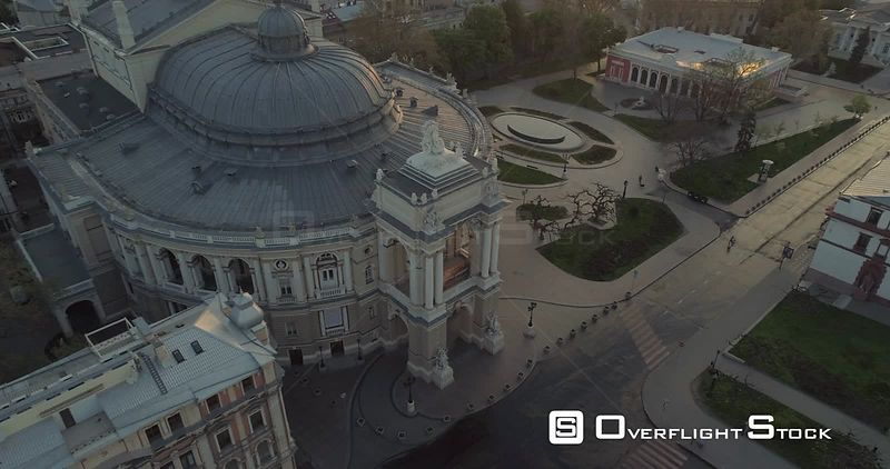 Aerial camera climbs up and away from the Odessa Opera Theatre and square at sunrise Ukraine