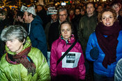 Amsterdam, Netherlands 2015-01-08: Demonstrants wearing newspaper-hats ands signs : 'Je suis Charlie'.