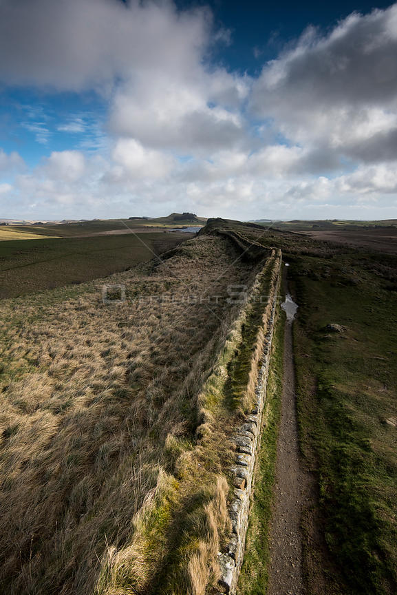 Elevated view along Hadrian's Wall. The wall is constructed on The Whin Sill, a layer of hard intrusive, volcanic Dolerite.