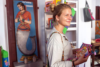 French tourists buy souvenirs in the Cafe Des Arts, Pondicherry, India