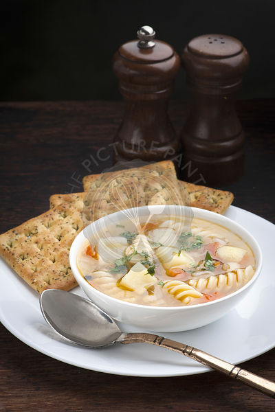 Chicken, potato and pasta soup with crackers