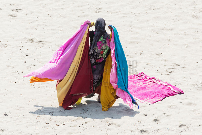 Woman Carrying Saris after Drying on a Sand Bar in the Yamuna River