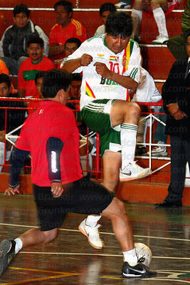 Bolivian president Evo Morales fights for the ball at a futsal tournament, La Paz, Bolivia