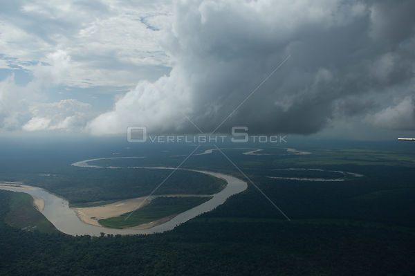 Aerial view of the Ichilo River and the rainforest (Amazon Basin) with storm clouds overhead, Santa Cruz Department, Eastern ...