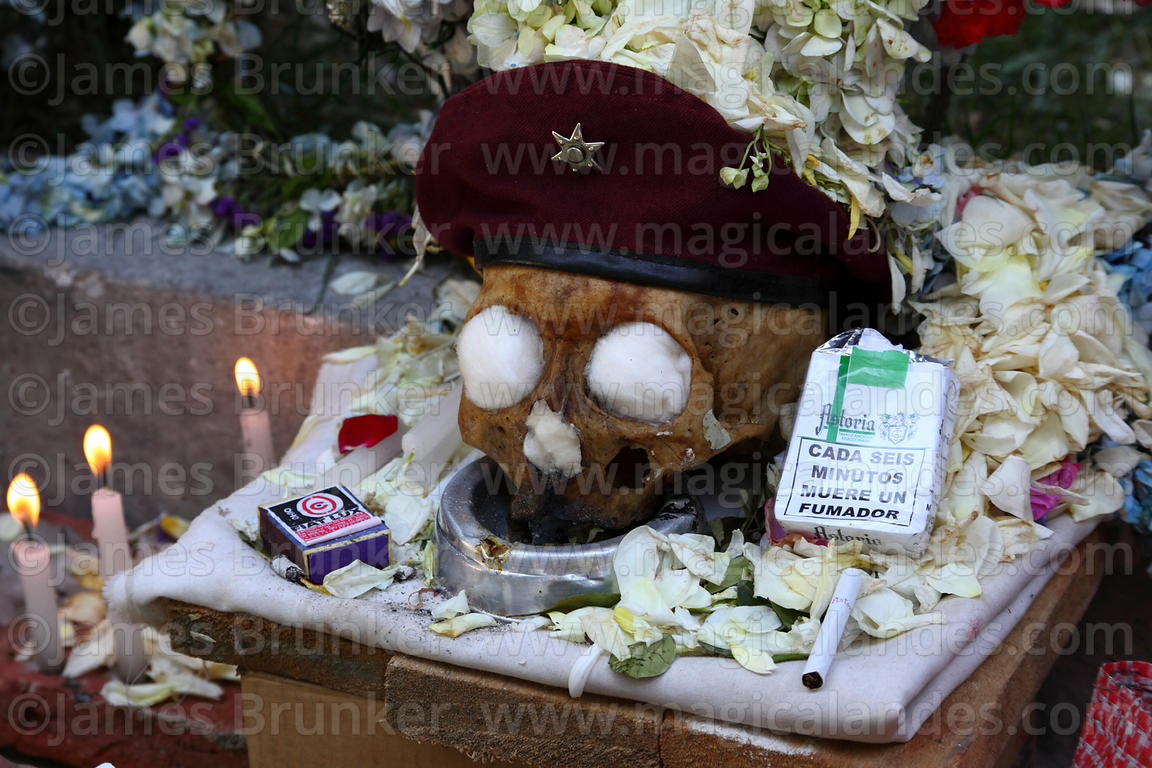 Skull with cigarette packet with health warnings in Spanish, Ñatitas festival, La Paz, Bolivia