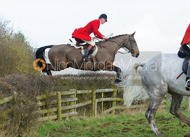 Elliott Stokes jumping a hedge with the The Belvoir Hounds at Ingarsby Hall 3/2