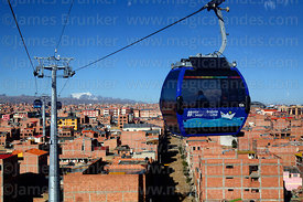 Blue Line cable car cabin with Mar para Bolivia / Sea for Bolivia slogan on it, Mts Mururata (L) and Illimani (R) in backgrou...