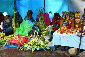 Stalls selling Easter eggs and ornaments and crosses made out of palm leaves on Palm Sunday, La Paz, Bolivia