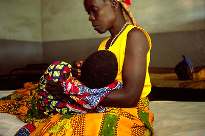 Rwanda - Kibileze - Alphonsine is held by her mother at the Kirarambogo Health Centre