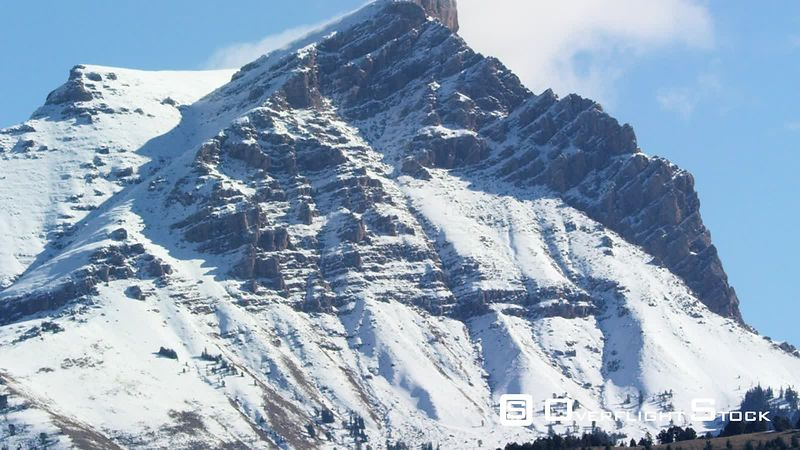 Sphinx mountain is a prominent mountain peak on the western face of the Madison range in southwestern Montana, and towers abo...