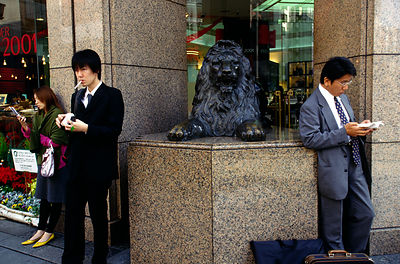 Customers wait for a department store to open in Ginza district, Tokyo, Japan