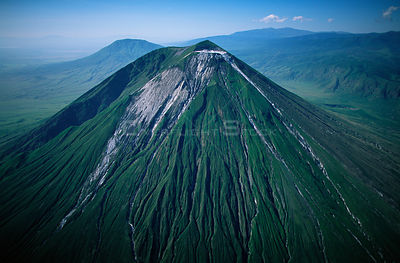 Aerial view of Ol Doinyo Lengai  (The Mountain of God) Volcano, Rift Valley, Tanzania. Note- light gray flows known as 'squee...