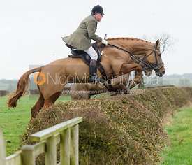 Johnnie Arkwright jumping a hedge above Chadwell