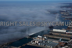 Liverpool aerial photograph of Low lying cloud and fog over the River Mersey and Liverpool Docks with the wind turbines risin...