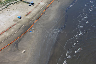 Aerial view of Slickbar oil booms on the beach at Grand Isle, used in the clean up and containment of hazardous oil, from the...