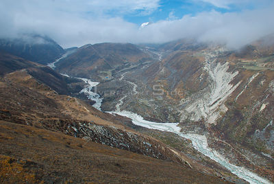 NEPAL Gokyo Valley -- A landscape showing the terminus of the Ngozumpa Glacier and the tiny hamlet of Nha.