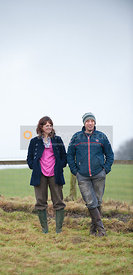 Nina Lloyd-Jones and Stuart Ward watch Piggy French on the gallops
