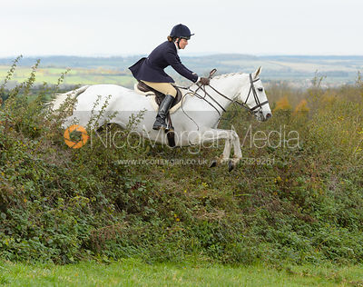 Harriet Rimmer jumping a hedge above Clawson Thorns