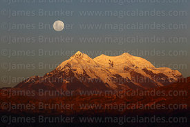 Full moon rising above Mt Illimani at sunset, Cordillera Real, Bolivia