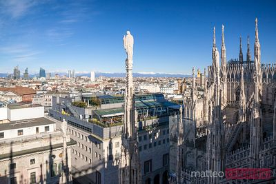 Milan skyline from the top of the Duomo, with alps in the background