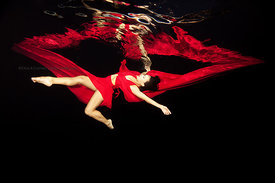 Bodyart Dance in pool underwater at night with black drape; Michele Jongeneel in red dress and red fabric
