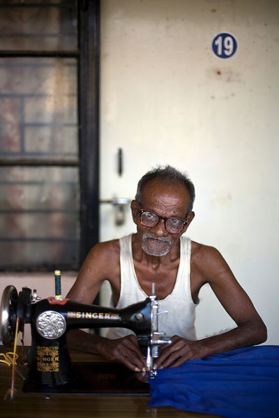 India - Cuddalore - Tanghavil at work at his sewing machine