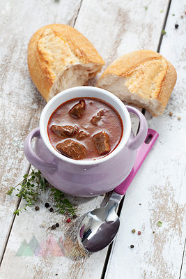 oulash soup with white bread in bowl, close up