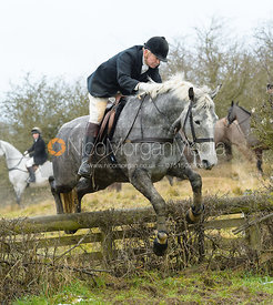 PC jumping the hunt jump at Newbold - The Fitzwilliam Hunt visit the Cottesmore at Burrough House