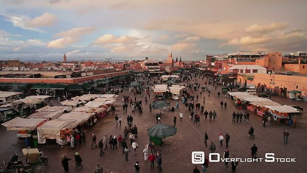 People visiting and walking through the Djemaa elFna market, Marrakech, Morocco, 2011.