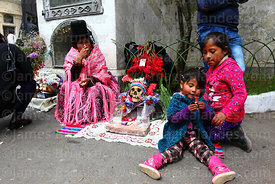 Girls playing next to skull in cemetery, Ñatitas festival, La Paz, Bolivia