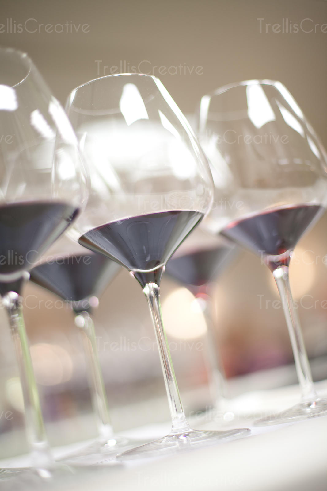 Low angle view of red wine glasses