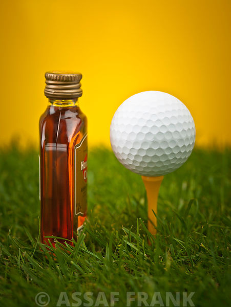 Golf ball with a bottle of Whisky