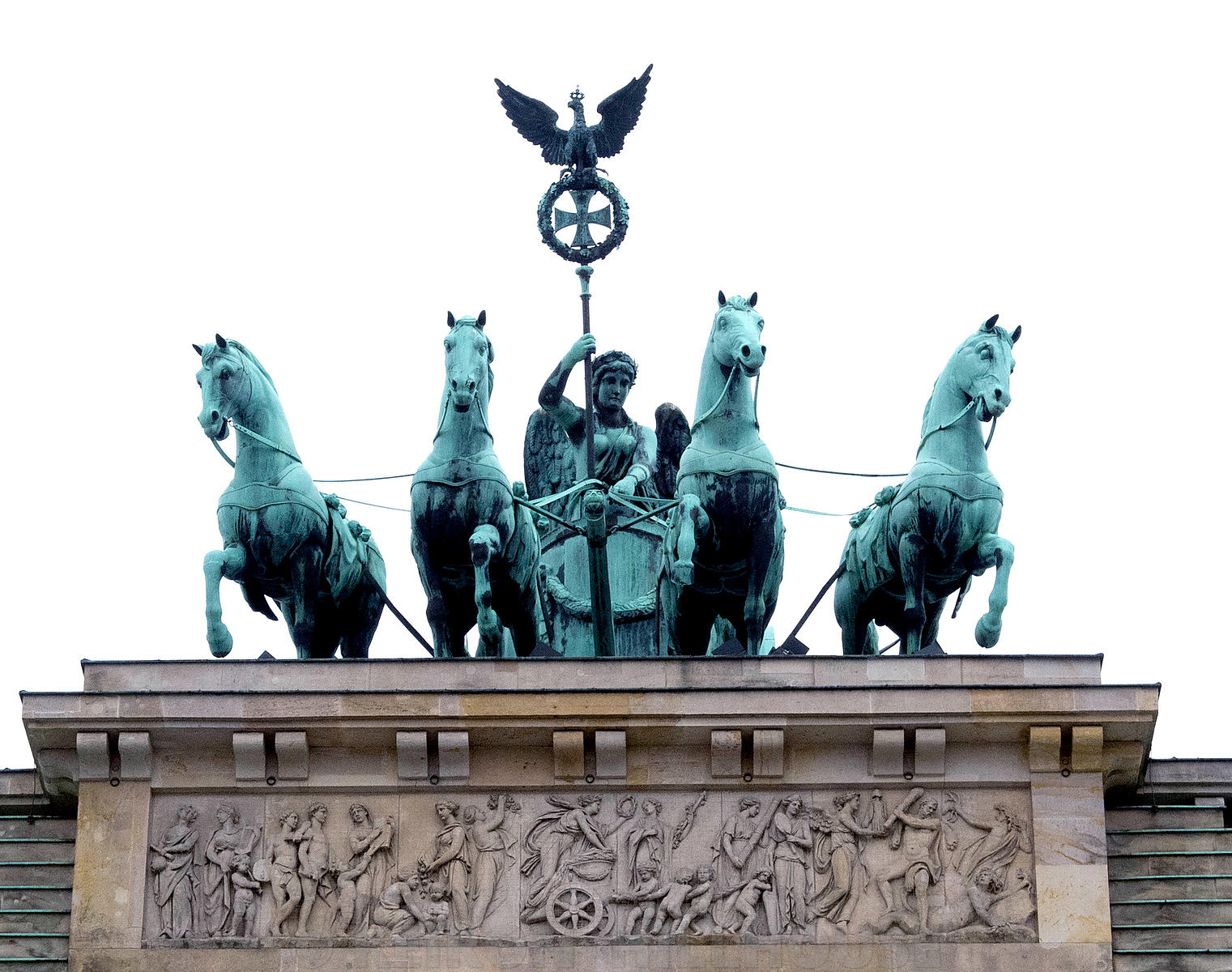 Quadriga, a chariot drawn by four horses driven by Victoria, the Roman goddess of victory atop of The Brandenburg Gate