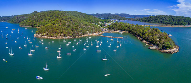 Aerial views of Brooklyn on the Hawkesbury River and its estuarine waterways and bays have many luxury yachts moored in its w...