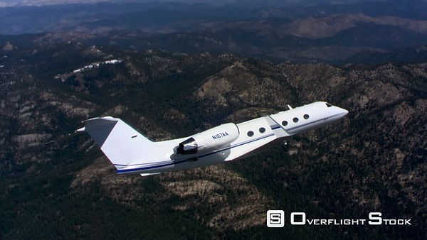 Air-to-air view of executive jet at close range