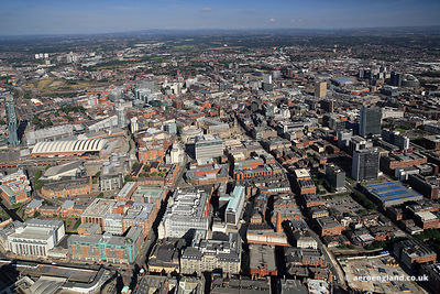 Panoramic cityscape aerial photograph of Manchester England UK