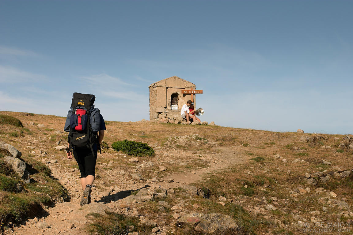 Hiker reaching a shrine