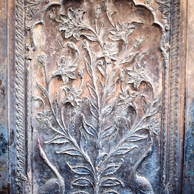 A typical Mughal depiction of a garden on a stone pillar outside an old Haveli