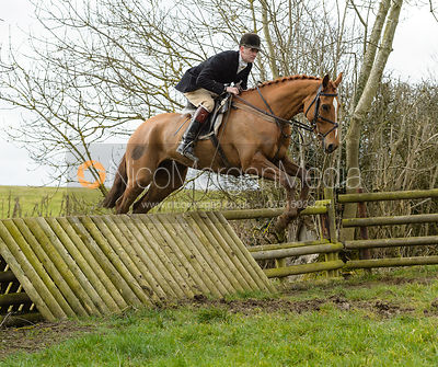 Ollie Finnegan jumping a fence at Peake's Covert