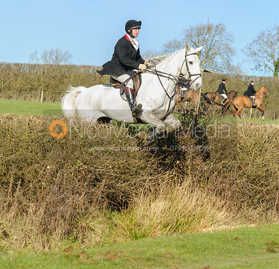Joss Williams jumping a hedge near Knossington village