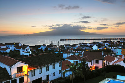 The city of Horta with the Pico volcano on the horizon, at dawn. Faial, Azores islands, Portugal