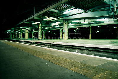 An atmospheric image of an empty train platform at a station In London, England.