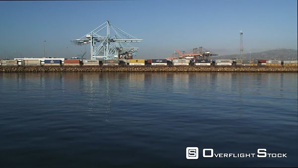 Flight from Water Level Passing Over Loading Cranes and Container Ships in Los Angeles Harbor.